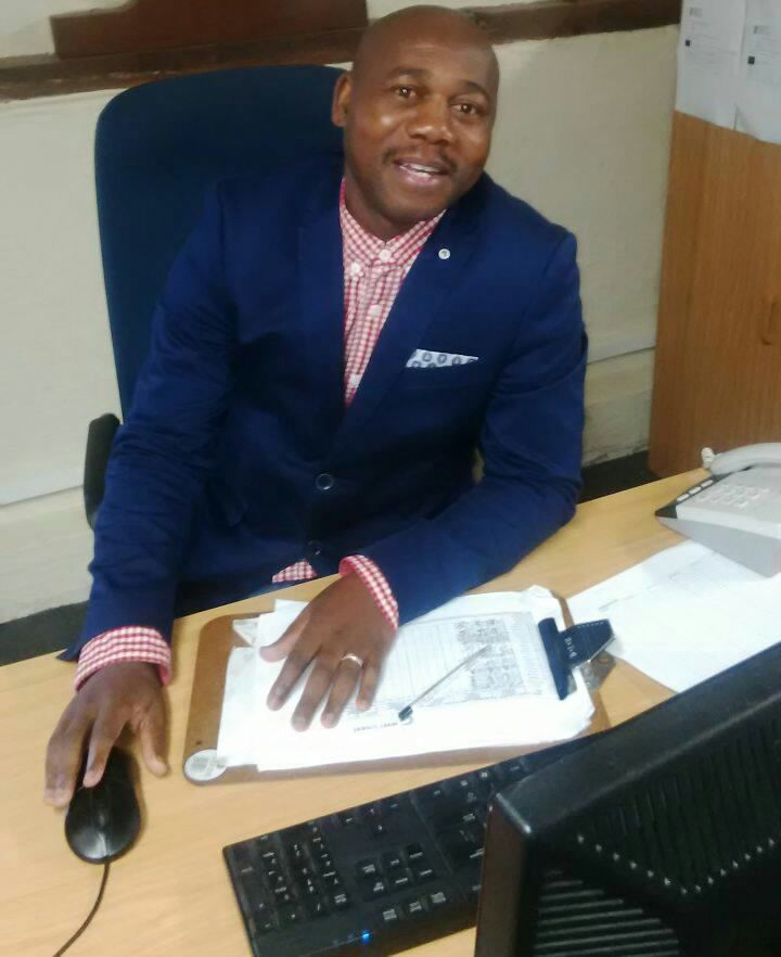 Mr Andile Ngqameni